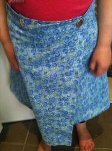 About 60cm of fabric, a lovely 60's pattern and a coupe of press studs in lieu of buttons and we have a sweet little wrap around skirt.