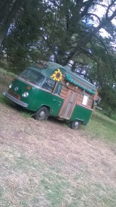 Gypsy is a converted VW wagon with a bed, small wood stove/heater, fridge and sink.